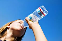 Drink eight ounces of water every hour during your flight.
